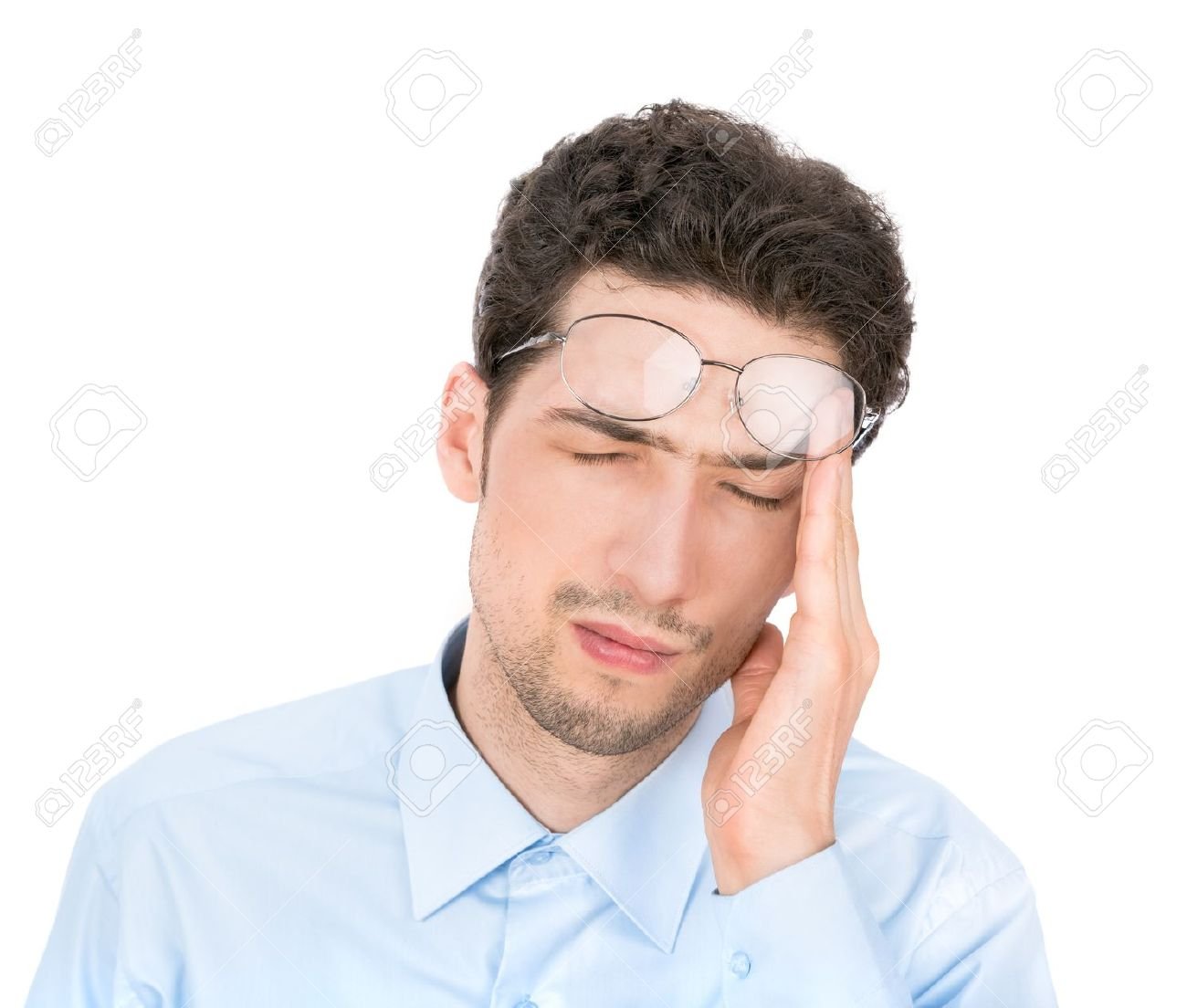 19147748-handsome-young-businessman-suffers-from-a-headache-isolated-on-white-background-stock-photo